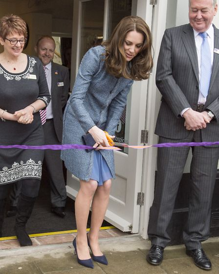 The Duchess of Cambridge cuts the ribbon to open a new charity shop for East Anglia's Children's Hos