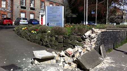 A van has hit a wall outside King's House in Thetford.
