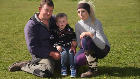 Laura, Steve and three-year-old Rylan White in the field at Reepham where their Shetland pony Scrump