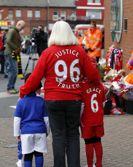 Supporters arrive for the last memorial service to be held at Anfield, Liverpool, to mark 27 years t