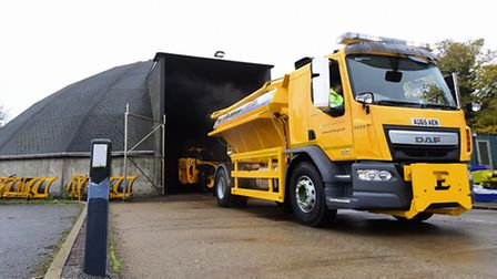 One of the Norfolk County Highways gritter lorries at the salt dome at the depot at Ketteringham. Pi