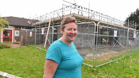 Southtown Primary School Headteacher Elaine Glendinning next to the ongoing building work to the sch