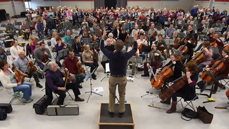 Conductor Matthew Andrews and the Norwich Philharmonic Orchestra settle in for their rehearsal for t