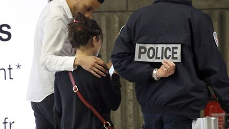 A relative of the victims of the EgyptAir flight 804 is escorted at Charles de Gaulle Airport outsid