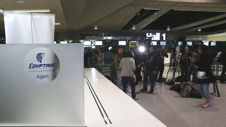 Reporters gather in front of the EgyptAir counter at Charles de Gaulle Airport outside of Paris, Thu