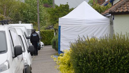 Police and Forensic Services carrying out a detailed search of the property and gardens on Holmesdal