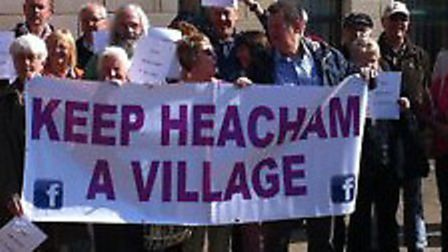 Residents in Heacham with their 'Keep Heacham a Village' banner at the start of a planning inquiry