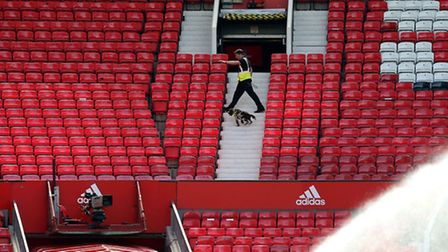Security search the stands during the Barclays Premier League match at Old Trafford, Manchester. PRE