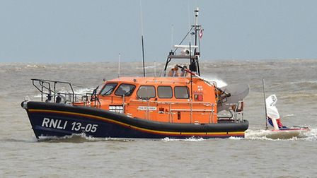 The Lowestoft lifeboat towed one of the dinghies back to the yacht club. Picture: Mick Howes