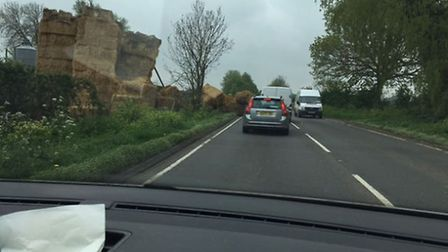 Straw bales toppled into the A146 between Norwich and Beccles. Christopher Mortimer