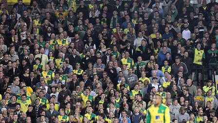 The home fans get behind their side during the Barclays Premier League match at Carrow Road, Norwich