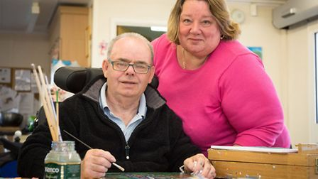Centre 81 member Richard Jex enjoys a painting session watched by wife Mary