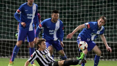 Action from Wroxham's win over Dereham in the Norfolk Senior Cup final at Carrow Road last year. Pic