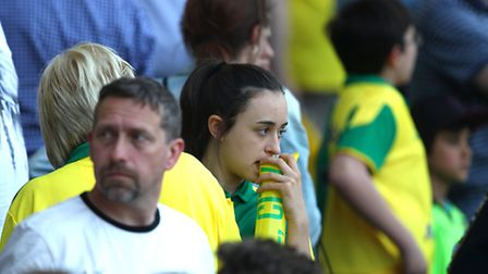 The Norwich fans look dejected at the end of the Barclays Premier League match at Carrow Road, Norwi