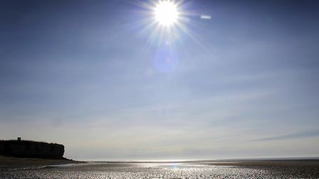 The sun high in the sky at Hunstanton beach. Picture: Matthew Usher