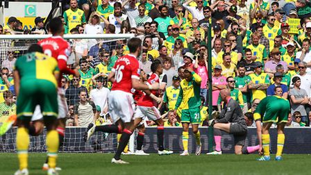 Manchester United's Juan Mata inflicts a 1-0 Premier League defeat on Norwich City. Picture by Paul