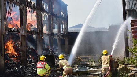 A fire destroys barns on a farm in Deopham.