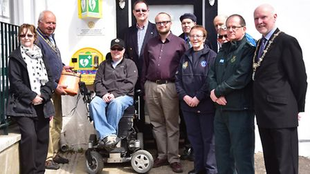 Defibrillators are being installed in Diss by the Rotarians. This one is outside Adkins Opticians an