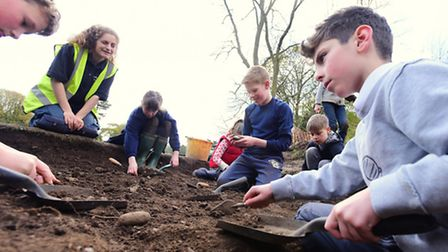 Under the guidance of Lilly Hodges from NPS Archaeology, pupils at Langley Preparatory School take p