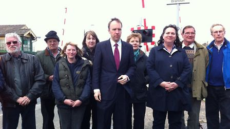 Matthew Hancock MP meets Helen Warnock, Network Rail area director, and residents at the level cross
