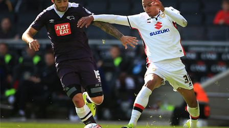 Josh Murphy tussles with former Norwich City team-mate Bradley Johnson in MK Dons Championship game