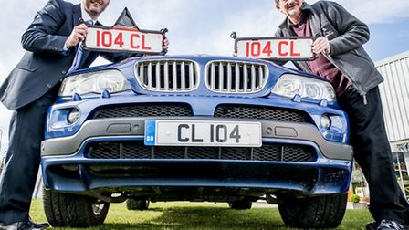 Chris Liles, right, with his personalised number plate which is the reverse of Cookes of Fakenham's