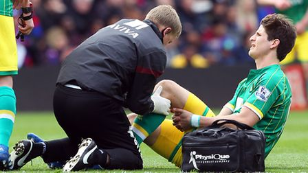 Timm Klose of Norwich recieves treatment at Selhurst Park, London. Picture by Paul Chesterton/Focus