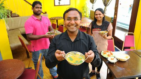 Vijay Jetani, centre, at his vegetarian Indian restaurant Namaste India in Opie Street, with his wif