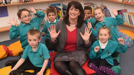 Garrick Green Infant School head, Rebecca Dewing, with pupils celebrating their good Ofsted. Picture