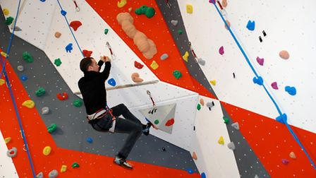 Climbers demonstrate the new climbing wall at the Morley Village and Sports Hall, near Wymondham.