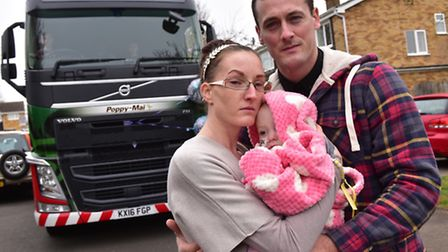 Poppy-Mai Barnard with her family, mum Sammi and dad Andy in Thetford. An Eddie Stobart lorry was na