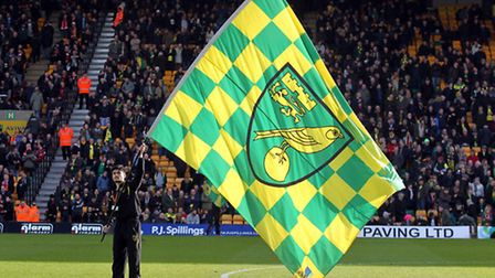 A Norwich flag is waved before the Barclays Premier League match at Carrow Road, Norwich. Picture by