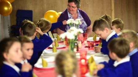 Dinner lady Sandra McGivern having a special leaving lunch with some of the pupils. Picture: Antony