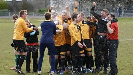 Great Yarmouth Town toast their promotion.