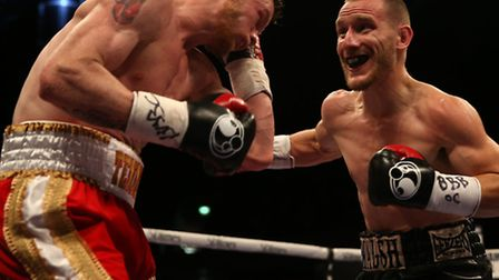 Ryan Walsh, right, and James Tennyson in action at the Copper Box Arena. Picture: ADAM DAVY/PA