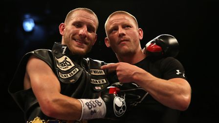 Ryan Walsh, left, celebrates victory over and James Tennyson. Picture: ADAM DAVY/PA