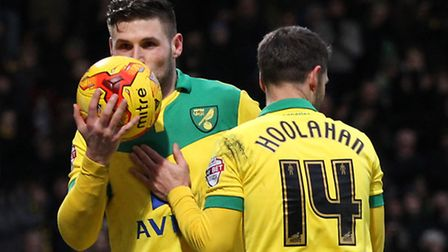 Gary Hooper of Norwich kisses the ball after completing his hat trick from the penalty spot during t