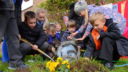 Pupils dig up their 2012 Olympic time capsule at Angel Road Infant School.PHOTO BY SIMON FINLAY