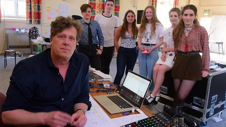 Rehearsing with director Pol Heyvaert, young singer singwriters from Norfolk who have created the sh