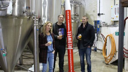 From left, Amy Hancock, Ben Jarvis and Patrick Fisher with one of their new rockets