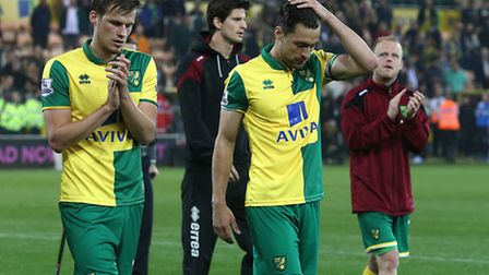 Russell Martin of Norwich and Ryan Bennett of Norwich look dejected during the lap of appreciation a