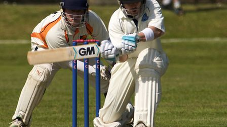Cricket action from Cromer v Diss; Cromer batting with Cromer fielding. Robert Purton batting with D