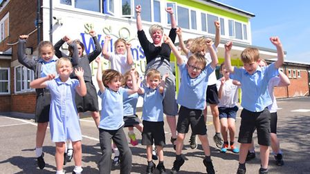 """Head teacher Sarah Shirras and pupils at St William's Primary celebrate being judged """"good"""" in all a"""
