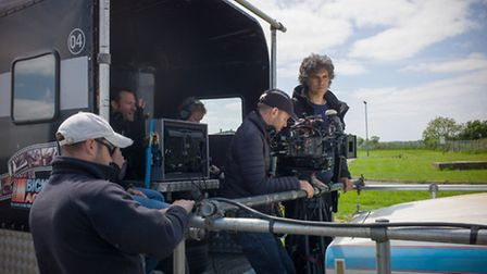 The Chameleon: Cast and Crew on a low loader on location in Hemsby. Photo: October Films