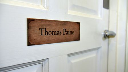 Thomas Paine Hotel owner Gez Chetal with the newly named room, nameplates.