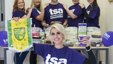 India Royall (front) is holding a bake a sale at Anglia Home Improvements in Lenwade in aid of the T