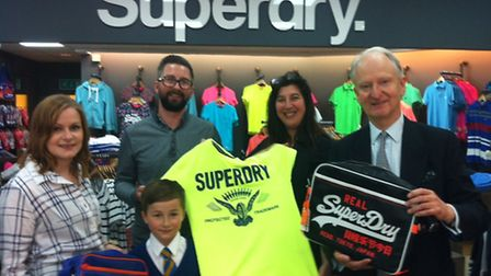 Sir Henry Bellingham at Superdry in King's Lynn: Pictured L-R, Sarah Wilson, the couple's son Harris