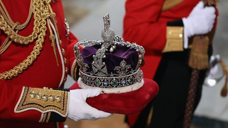 The Imperial State Crown is carried into the Houses of Parliament on May 18 in London, England. (Ph