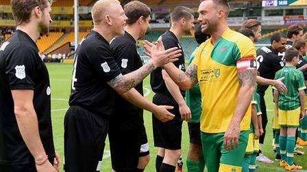 Jamie's Game celebrity football match charity event at Carrow Road. Calum Best chats to Gary Holt in