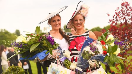 Ladies Day at Fakenham Racecourse. Pictured are (L) best hat winner Carrie Massingham with best dres